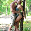 Beautiful man and woman holding and kissing on the nature. — Stock Photo #13244313