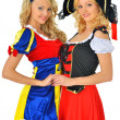 Two women in carnival costumes of Pirate and Snow White. — Stock Photo #13519416