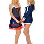 Two beautiful women in carnival sexy costumes of seaman. — Stock Photo #13519439