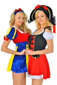 Two women in carnival costumes of Pirate and Snow White. — Stock Photo