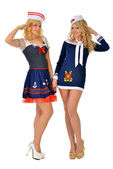 Two beautiful women in carnival sexy costumes of seaman. — Stock Photo