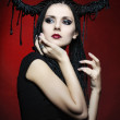 Beautiful woman in carnival costume. witch shape with Horns. — Stock Photo #13651621