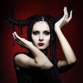 Beautiful woman in carnival costume. witch shape with Horns. — Stock Photo