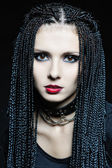 Beautiful woman in gothic shape with african pigtails . — Stock Photo