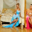 Two beautiful women celebrating event in luxury interior. — Stock Photo