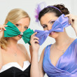 Stock Photo: Two beautiful woman in evening gowns having fun.