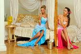 Two beautiful women celebrating event in luxury interior. — Stock Photo