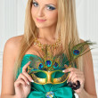 Stock Photo: Beautiful womin evening gown with carnival mask.