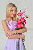 Beautiful woman with orchid — Stock Photo