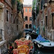 Venetian gondola staying at the canal. — Stock Photo