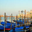 View to the gondolas and boats berth  in Venice. — Stock Photo