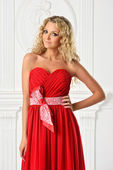 Beautiful blonde woman in red dress. — Stock Photo
