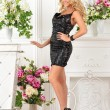 Beautiful womin black dress in luxury studio. — Stock Photo #28692079