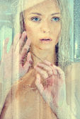 Beatiful blonde naked woman in a shower. — Stock Photo