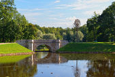 Summer landscape with lake and bridge in Gatchina park, — Stock Photo