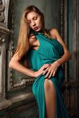 Sexy beautiful woman green gown in palace. — Stock Photo