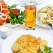 Table with food of meat on skewer, dumplings and gass of juice. — Stock Photo #42791531