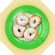 ������, ������: Green dish with donuts coated with powdered sugar