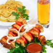 Table with food of meat on skewer, dumplings and gass of juice. — Stock Photo #42791581