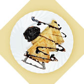 Dish of crepes with chokolate sause on white plate. — Stock Photo