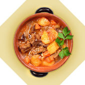 Dish of meat soup with potatoes in ceramic pot. I — 图库照片