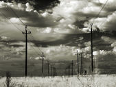 High-voltage power lines in the steppe. Infrared. — Stock Photo