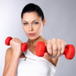 Beautiful young woman with dumbbells — Stock Photo #14822917