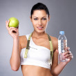 Healthy woman with apple and bottle of water — Stock Photo