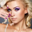 Beautiful woman with beauty purple manicure and makeup of eyes. — Stock Photo #14993757