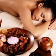 Woman after massage in spa salon - Stock Photo