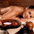 Woman after massage in spa salon — Stock Photo