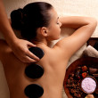 Woman getting hot stone massage in spa salon. — Foto de Stock   #14994309