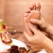 Massage of human foot in spa salon — Stock Photo #14994851