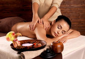Woman having massage in the spa salon — Stok fotoğraf