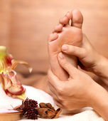 Massage of human foot in spa salon — Stock Photo
