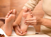 Massage of human foot in spa salon — Stock Photo
