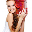 Pretty girl holding present — Stock Photo #1502621