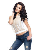 Fashion model with long hair dressed in blue jeans — Stock Photo