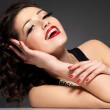 Young pretty woman with red manicure and lips — Stock Photo