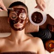 Stock Photo: Spa therapy for woman receiving cosmetic mask