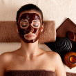 Woman relaxing with facial mask on face at beauty salon — Stock Photo