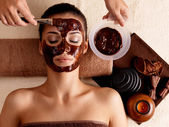 Spa therapy for woman receiving cosmetic mask — Stock Photo