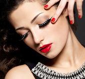 Woman with creative makeup using false eyelashes — Stock Photo