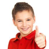 Lycklig pojke visar tummen upp gest — Stockfoto