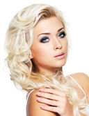 Beautiful blond woman with saturated makeup. — Stock Photo