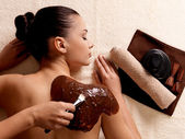 Spa therapy for young woman receiving cosmetic mask — Foto de Stock