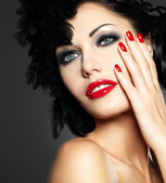 Woman with red nails and creative hairstyle — Stock Photo