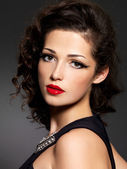 Brunette woman with fashion makeup and red lips — Stock Photo
