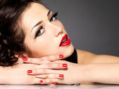 Beauty fashion woman with red nails and makeup — Stock Photo
