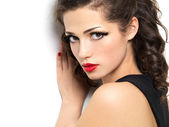 Beautiul fashion girl with red manicure and lips — Stock Photo